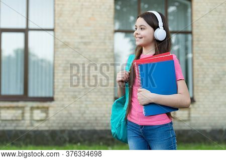 Primary Modern School. Happy Girl Wear Headphones Outdoors. Modern Life. Little Child Listen To Mode