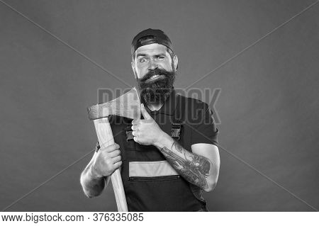 Brutal Job. Dismantling And Demolition Of Structures. Bearded Lumberjack. Man Builder Uniform Hold A