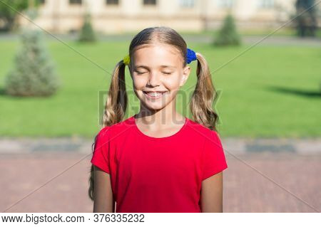 Happiness Of Childhood. Happy Child With Closed Eyes Sunny Outdoors. Small Girl Feel Happiness. Enjo