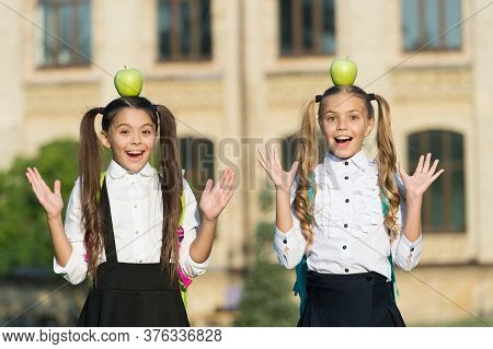 If It Makes You Happy Do It. Happy Girls Hold Apples On Head. School Break. Having Fun Outdoors. Lei