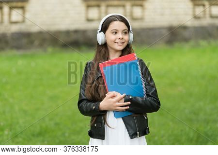Music Is Cool. Cool Child Listen To Music Outdoors. Happy Girl Use Headphones For Listening. Private