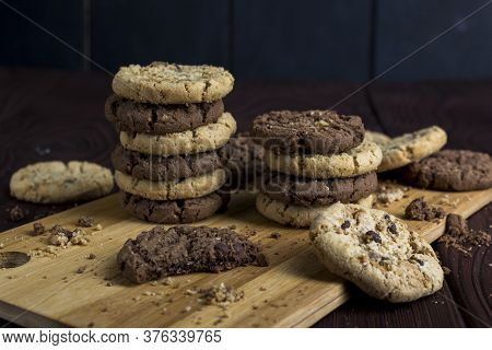 A Stack Of Light And Dark Chocolate Cookies Is Isolated. Delicious Chocolate Diet Treats For Vegans,