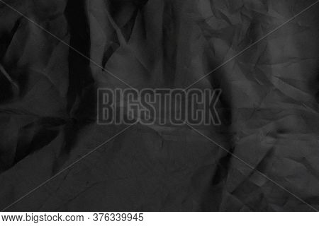 Black Wrinkled Material With Wrinkles And Contrasting Texture. Dusty Packaging. Abstract Dramatic Ba