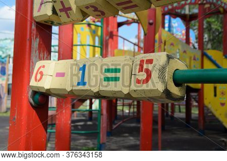 Large Wooden Cubes With Colorful Numbers On A Street Playground. Children's Games And Outdoor Traini