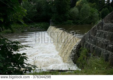 Wild Waterfall On A Forest Creek