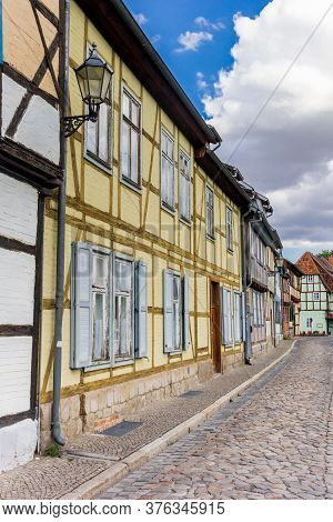 Cobblestones Street With Colorful Houses In Quedlinburg, Germany