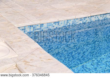 Blue Ripped Water In Swimming Pool In Tropical Resort With Edge Of Pavement. Part Of Swimming Pool B