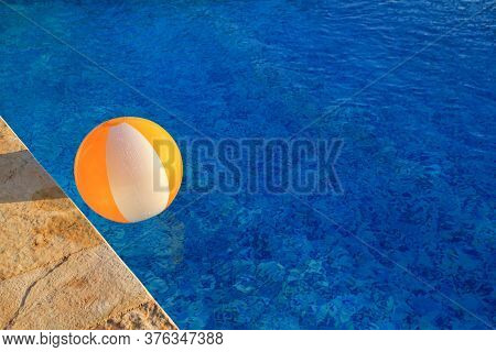 Rubber Air Yellow White Inflatable Ball And Toy For Swimming Pool In Transparent Blue Water. Multi-c