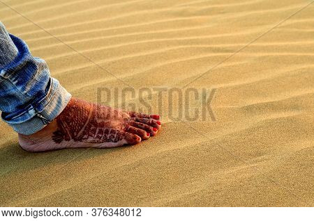 A Newly Married Woman Showing Her Foot With Henna Design In Sam Sand Dune, Thar Desert, Jaisalmer, R
