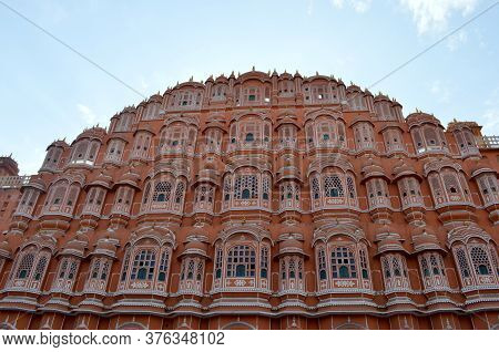 Low Angle Shot Of Hawa Mahal From Across The Street. Hawa Mahal Is Constructed Of Red And Pink Sands