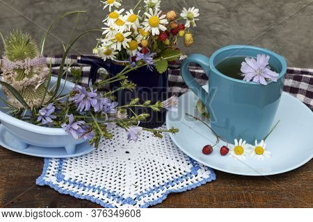 On The Table Is A Bouquet Of Daisies And Wild Strawberries, A Cup Of Tea With Chicory, Chicory Flowe