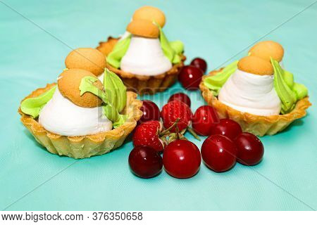 Pastry Baskets With Mushrooms Made Of Protein Cream And Fresh Cherries And Raspberries Are Next To T