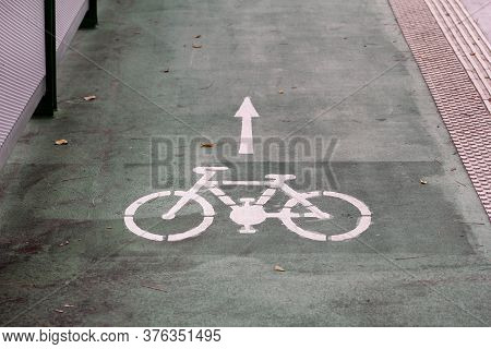 Bike Lane Symbol With A Direction Arrow On Ground. Bicycle Trail Road Sign On Modern Bridge For Bike