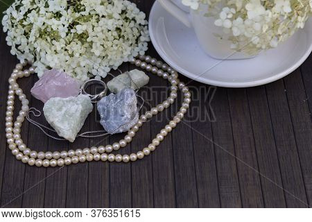 On A Wooden Background Are Natural Semiprecious Stones - Rose Quartz, Aquamarine, Prenite, Celestine