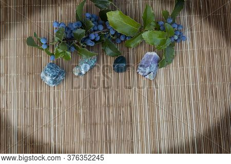 Shaded Corners. On A Wooden Background On The Side Are Semiprecious Stones - Heliotrope, Malachite,