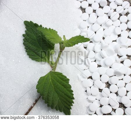 The Picture Shows Candy Leaf, Sugar And Sweetener On A Stone Floor