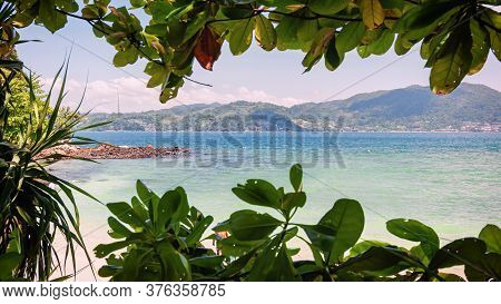Bay In The Andaman Sea Framed By Foliage.