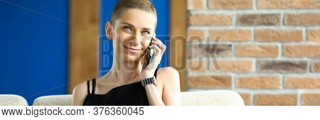 Portrait Of Smiling Attractive Female Talking On Mobile Phone. Short Haired Lady Sitting On Comfy Co