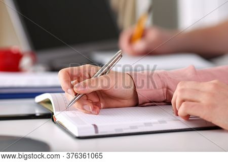 Close Up Female Hands Make An Entry In Diary. Long Internships Conducted By Modules For Several Mont