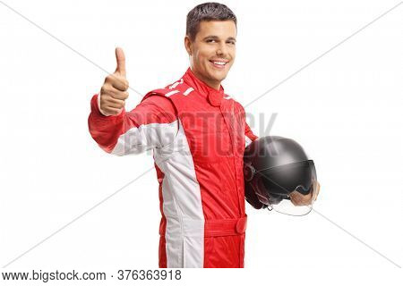 Car racer holding a helmet and showing thumbs up isolated on white background