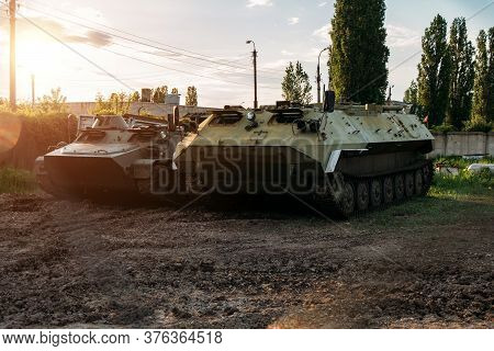 Old Russian Armored Vehicles On Sunset Background At Military Base