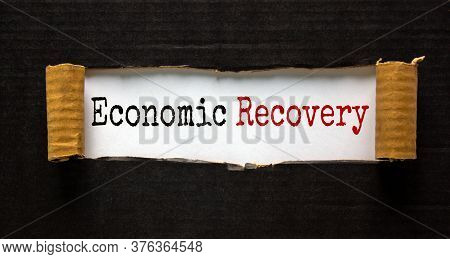 Words 'economic Recovery' Appearing Behind Torn Black Paper. Beautiful Background. Business Concept.