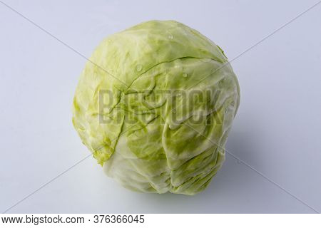 White Background. A Head Of White Cabbage. No Isolation. Eco Product