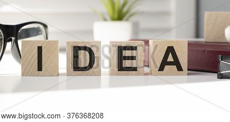 Idea. Creative Idea Concept In A Single Word. Idea Quote Printed On Wooden Blocks On Light Green Bac