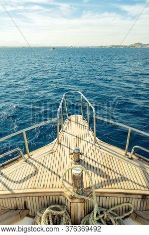 View From Fore Of Sightseeing Yacht To Sea Waves, Island Sore, Horizon. Ultamarine Waves Of Red Sea.