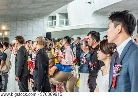 Yuchi, Taiwan - October 4th, 2019: several couples participate in a group wedding at the scenic spot of Sun Moon Lake, Nantou, Taiwan