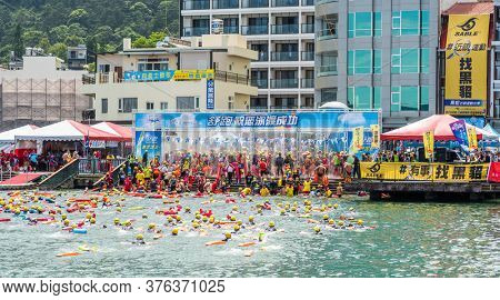Nantou, Taiwan - September first, 2019: Sun Moon Lake Swimming Carnival with huge numbers of people swimming to cross the lake, Nantou, Taiwan