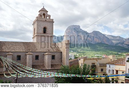 Detail Of The Church Of Polop De Marina With Rocky Mountainrange, Costa Blanca, Spain
