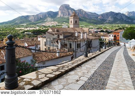 Street To The Village And Church Of Polop De Marina With Rocky Mountainrange, Costa Blanca, Spain