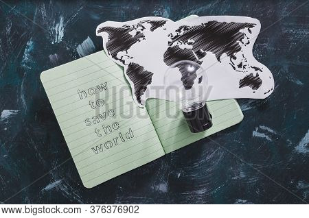 Concept Of Environmental Awareness, How To Save The Planet Text On Notepad With Light Bulb And World