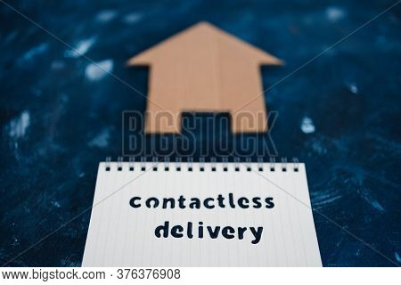 Contactless Delivery Text On Notepad With House Icon Concept Of Groceries Shopping During Quarantine