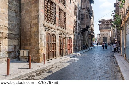 Cairo, Egypt- June 26 2020: Moez Street With Few Local Visitors And Sabil-kuttab Of Katkhuda Mamluk
