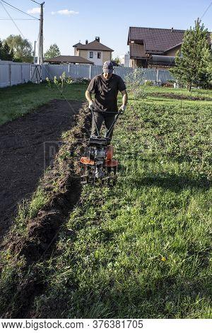 Man Plowing Land Tillers, Gardening And Farming