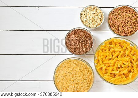 Group Of Wholegrain And Carbohydrates Food On Wooden Background. Copy Spase, Flat Lay