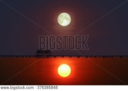 Reflection Of Sunset  Silhouette Bridge And Pavillion In Sea And Full Moon On Sky