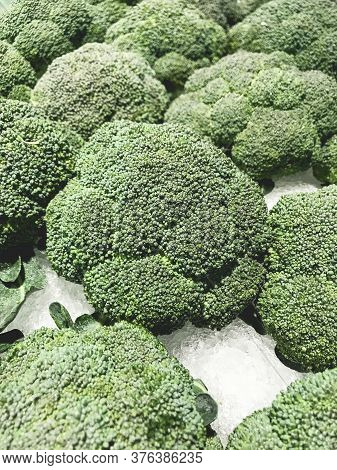 Closed Up Pile Of Broccoli In The Convenient Store.
