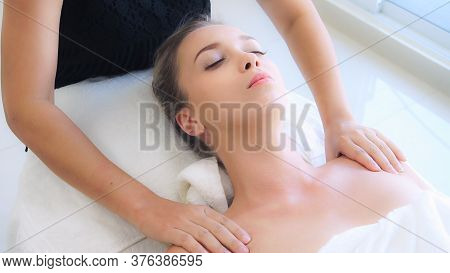 Relaxed Woman Getting Shoulder Massage In Luxury Spa By Professional Massage Therapist. Wellness, He