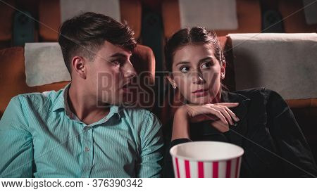 Men And Women Are Watching Mysterious Movies And Talking About The Stories That Happened In The Movi