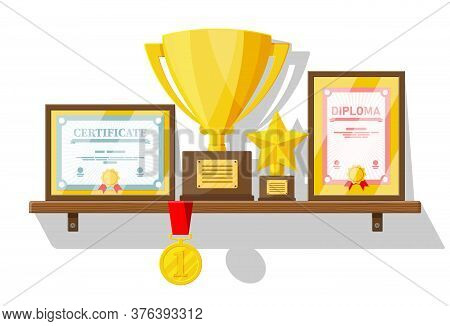 Trophy And Awards Collection On Wooden Shelf. Diploma And Certificate In Frames. Competition Prizes,
