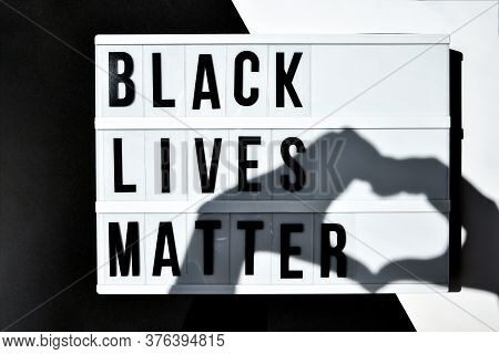 Black Lives Matter Text With Deep Shadows Of Heart On A Black And White Background. Protest Against