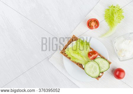 Cooking Of Healthy Dietary Sandwiches Of Dry Crisps Rye Bread With Vegetables - Green Salad, Cucumbe