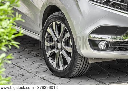 Tread Of A Wheel Of Car Standing In The Back Yard, Closeup.