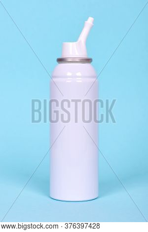 Nasal Spray Bottle, Sea Water For Cleanse. Isolated On Blue Background.