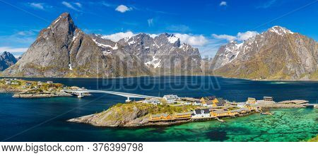 Island of Hamnoy, Lofoten Islands, northern Norway. Norwegian fishing village with  Fjord and Mountain In Background