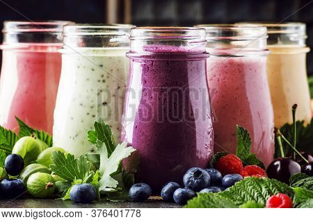 Healthy And Useful Colorful Berry Cokctalis, Smoothies And Milkshakes With Yogurt, Fresh Fruit And B