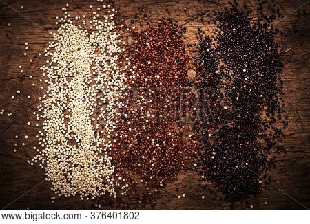 Quinoa Set. Black, White And Red Raw Quinoa Grains In Bowls, Groats Assorted, Wooden Rustic Kitchen